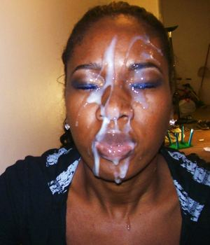 Black babe messy cumshot in her face