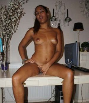 Naked Black Babe Plays With Her Pussy