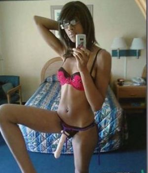 Skinny black amateur teen wearing strapon dildo